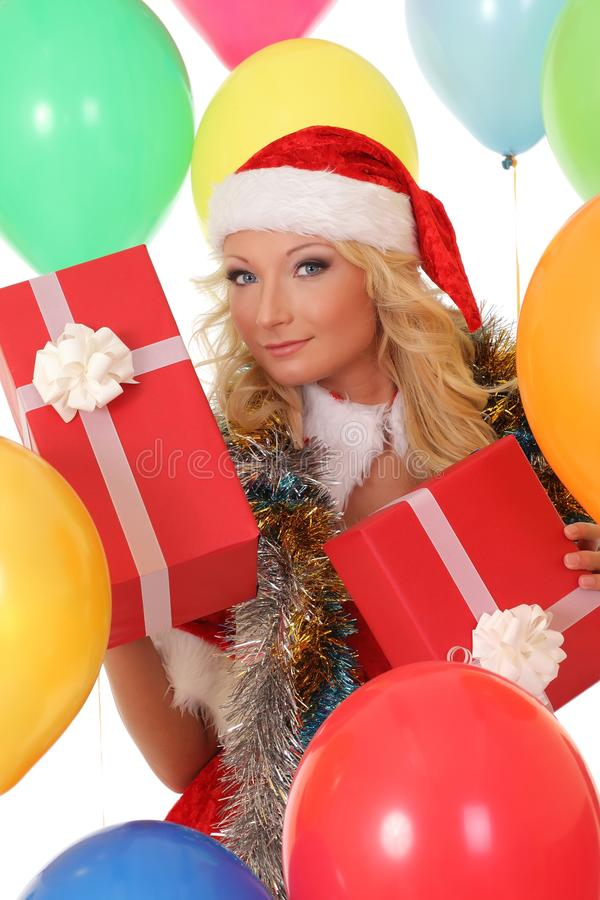 Happy girl in red Santa hat holding gift box stock photography