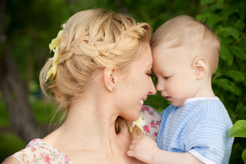Mother and son. Happy blond mom and one year old son enjoying nature together stock images