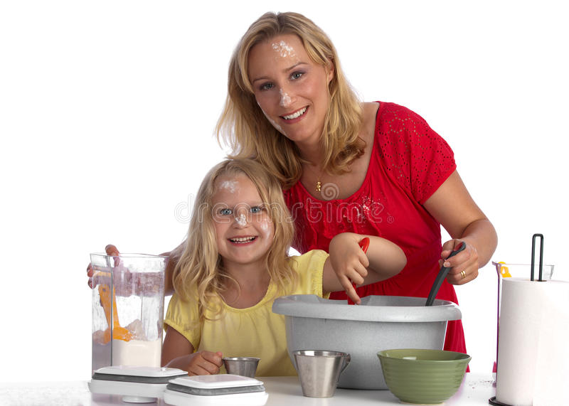 Happy blond mother and daughter baking royalty free stock image
