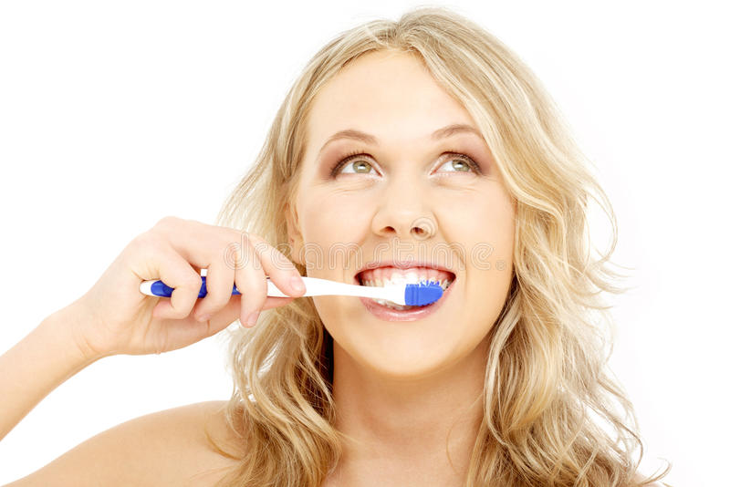 Happy blond with toothbrush stock photo