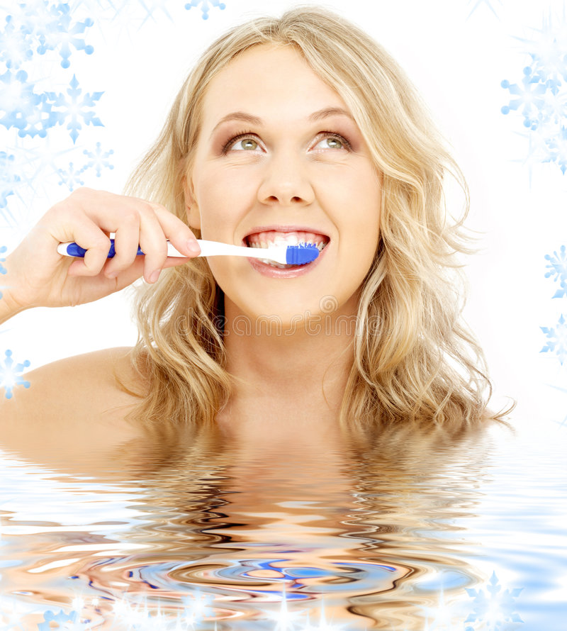 Happy blond with toothbrush in water royalty free stock images