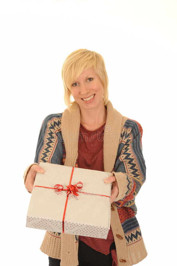 Happy blond woman with gift. Happy young blond woman with wrapped gift or present, isolated on white background royalty free stock photos