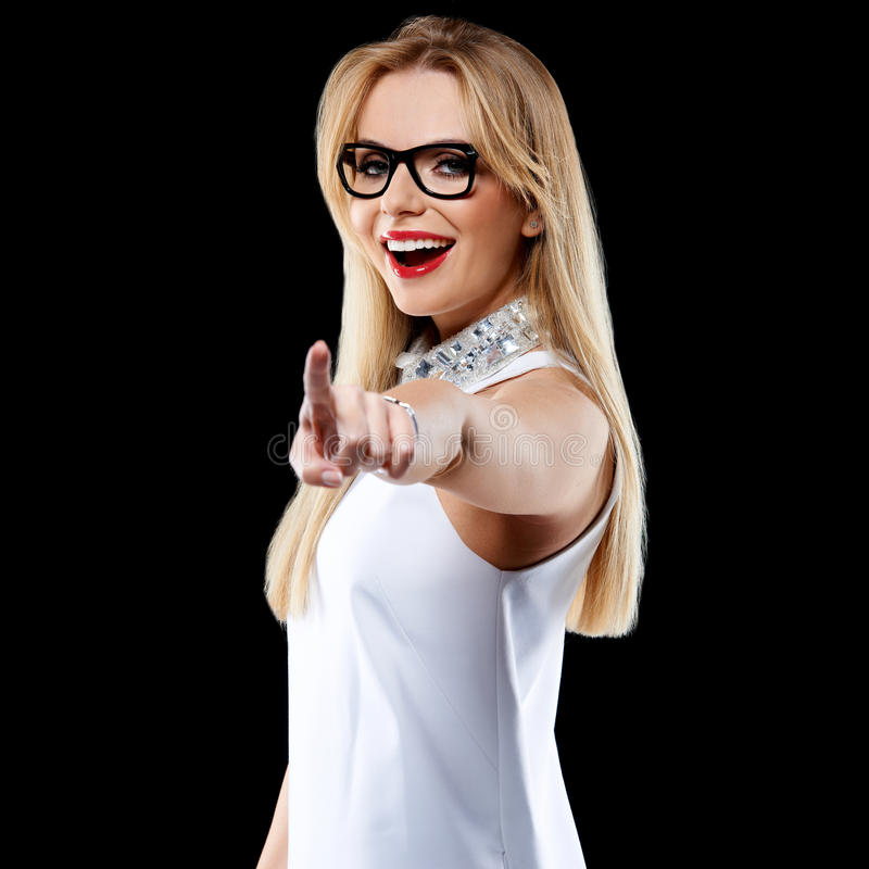 Happy Blond Woman Pointing at the Camera stock images