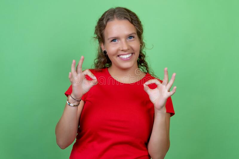 Happy blond woman with red shirt royalty free stock photos