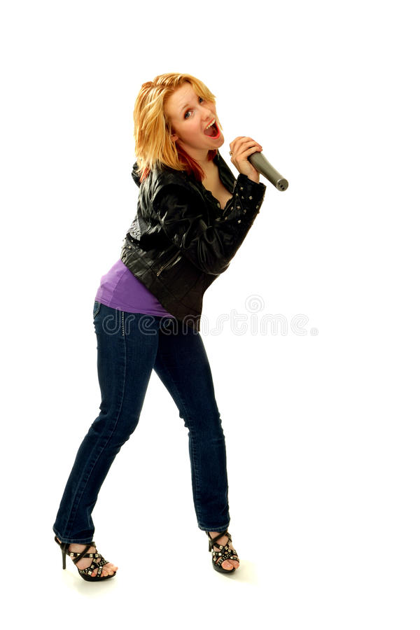 Happy Blond Woman Singing With Microphone Stock Image