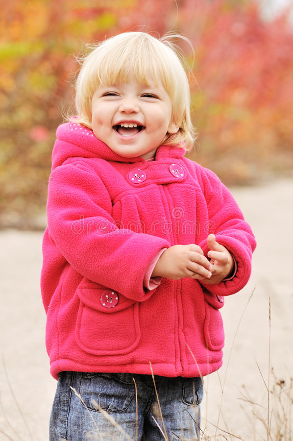 Happy blonde baby. With dimple cheeks stock images