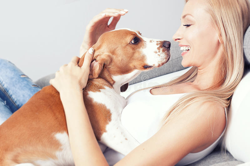 Happy blonde girl with beagle. stock photos