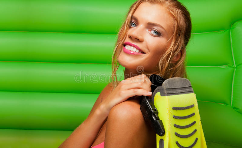 Happy blonde girl with fins royalty free stock image