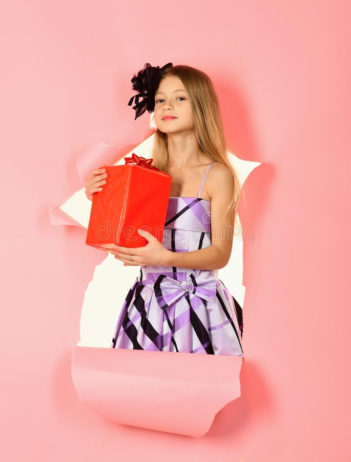 Happy Blonde Girl Opening a Present, birthday.  royalty free stock photos