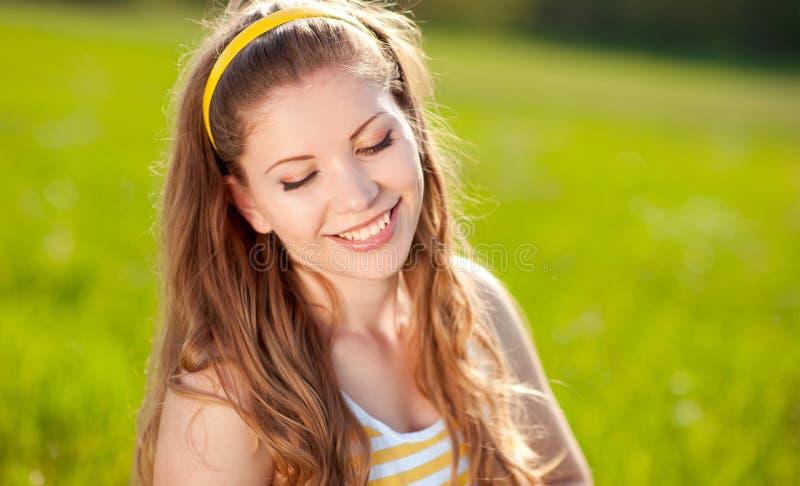 Happy blonde girl stock photo