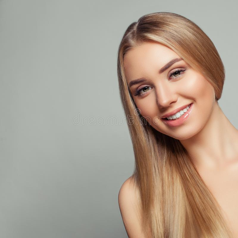 Happy blonde model woman with long healthy blonde hair royalty free stock image