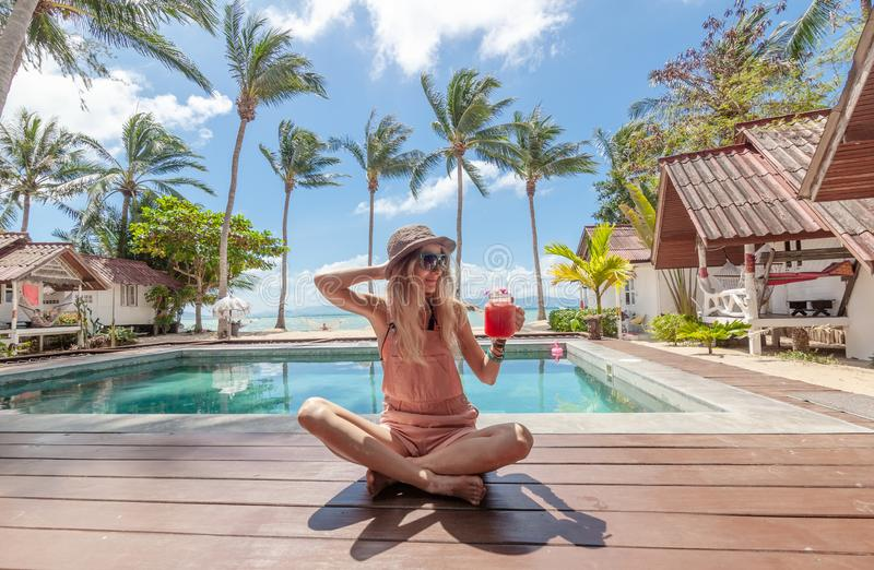 Happy blonde woman tropical background. Vacation, summer. Healthy lifestyle. Holiday concept. royalty free stock photo