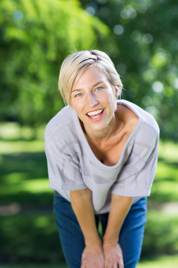 Happy blonde smiling at camera stock images