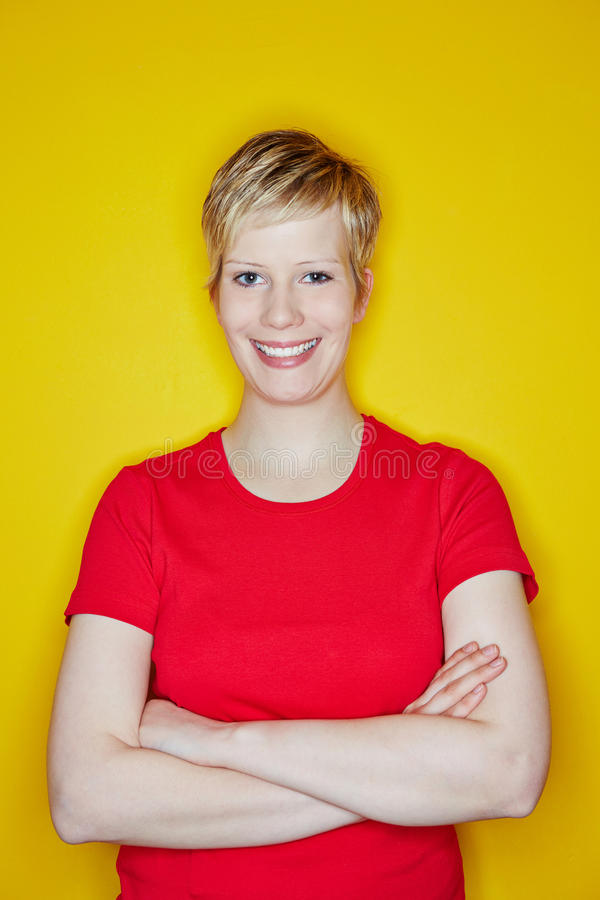 Happy Blonde Woman With Arms Crossed Royalty Free Stock Photo