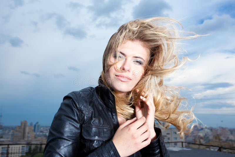 Happy blonde woman with hair blowing royalty free stock images