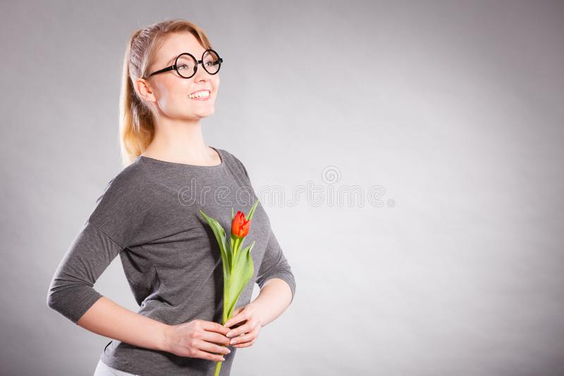 Happy blonde woman with spring flower royalty free stock images