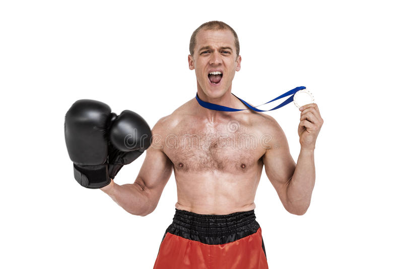 Happy boxer showing his silver medal. On white background stock photo