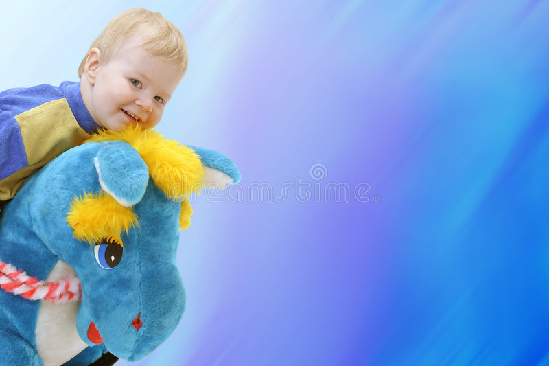 Happy boy. Baby on the blue background royalty free stock image