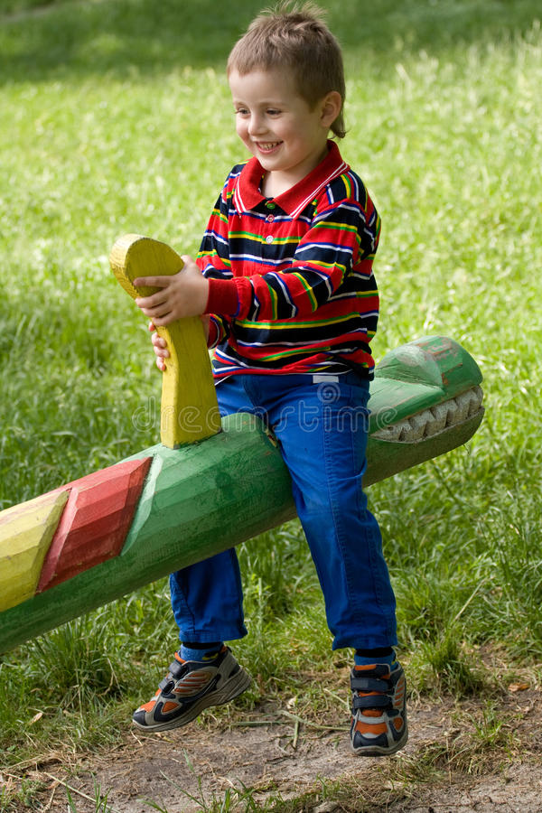 Download Happy boy stock photo. Image of seesaw, active, attractive - 9952642
