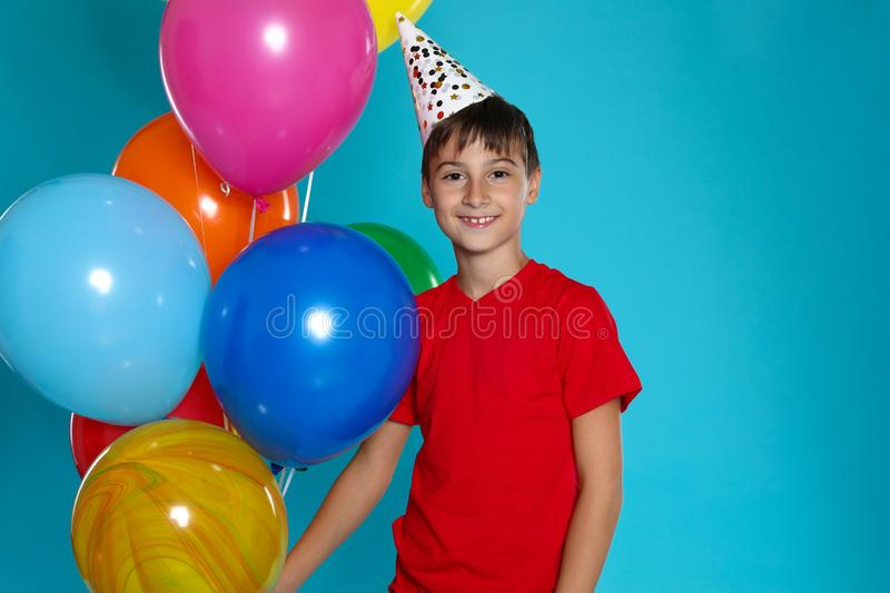 Happy boy with balloons. Birthday celebration stock photography