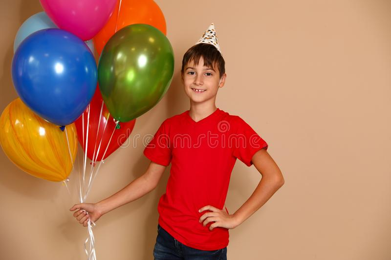 Happy boy with balloons. Birthday celebration royalty free stock photos