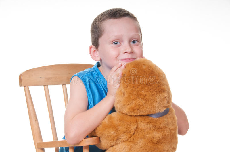 Happy boy with bear friend royalty free stock photo