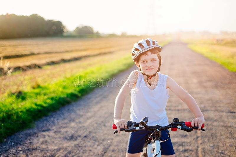 Happy boy in a bicycle helmet on his bike. Child on bike royalty free stock photos