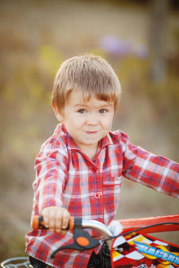 Download Happy Boy On A Bicycle In A Summer Park Stock Photo - Image: 36712022