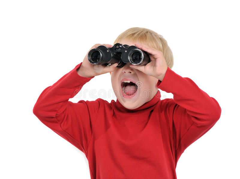 Happy boy with binoculars. Isolated on white royalty free stock photos