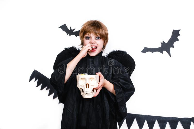 Happy boy in a black angel costume having fun royalty free stock photography