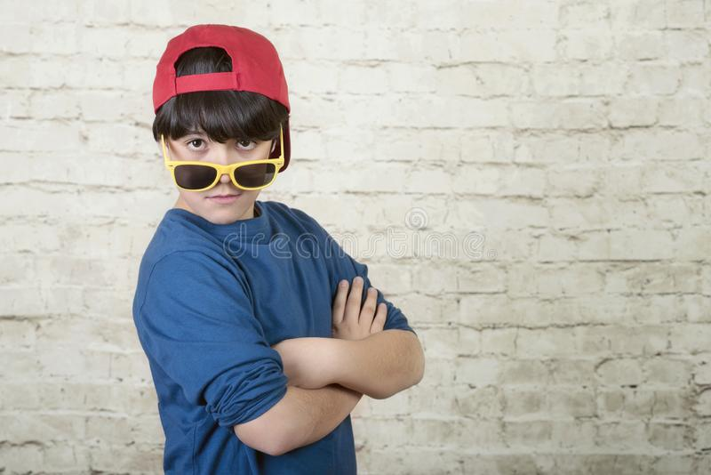 Happy boy with cap and sunglasses royalty free stock image