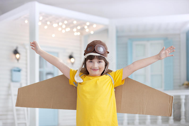 Happy boy with cardboard boxes of wings royalty free stock photography