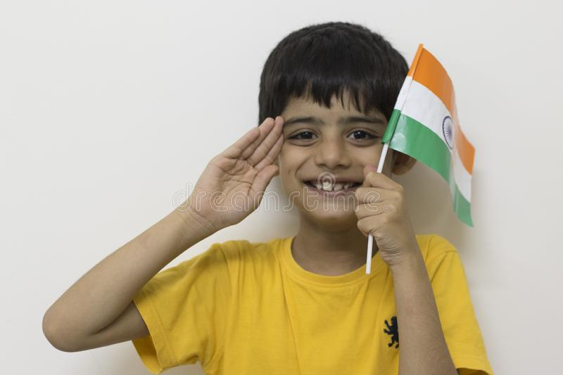 A happy boy celebrating Indian independence day. A happy boy with a big smile and Indian national flag during Independence day celebration royalty free stock image