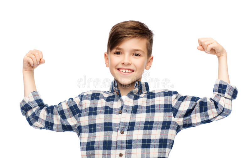 Happy boy in checkered shirt showing strong fists. Childhood, power, strength and people concept - happy smiling boy in checkered shirt showing strong fists royalty free stock images