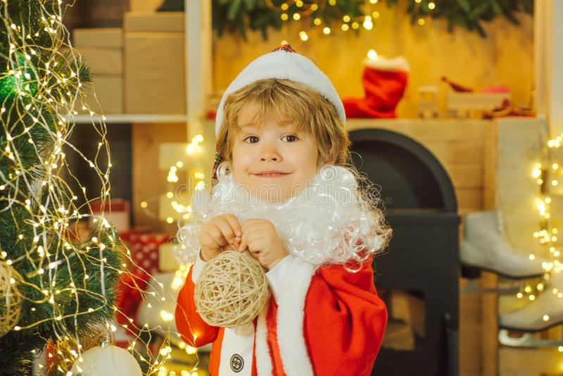 Happy boy with Christmas toy. Cute baby in Christmas Eve. Beautiful photo for greeting card. Happy New Year. royalty free stock photos
