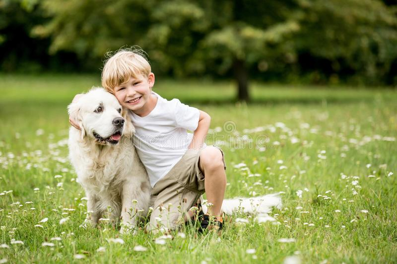 Happy boy and dog as friends. As love your pet concept stock photo