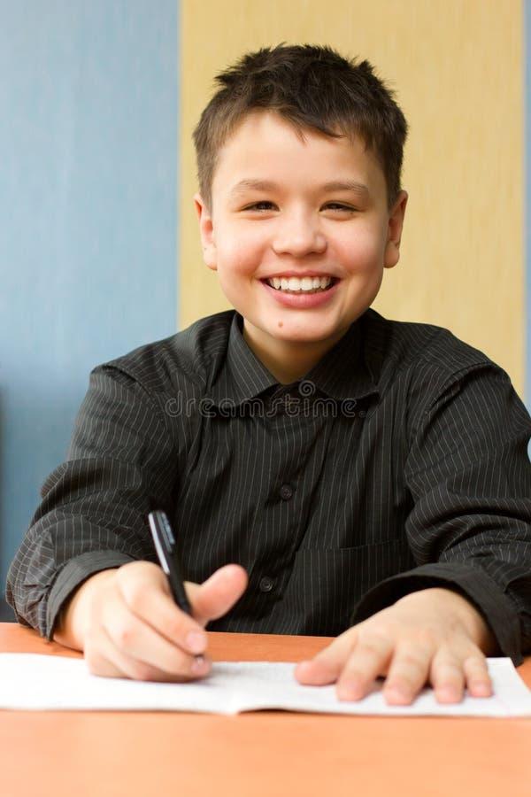 Happy boy doing lessons stock photo