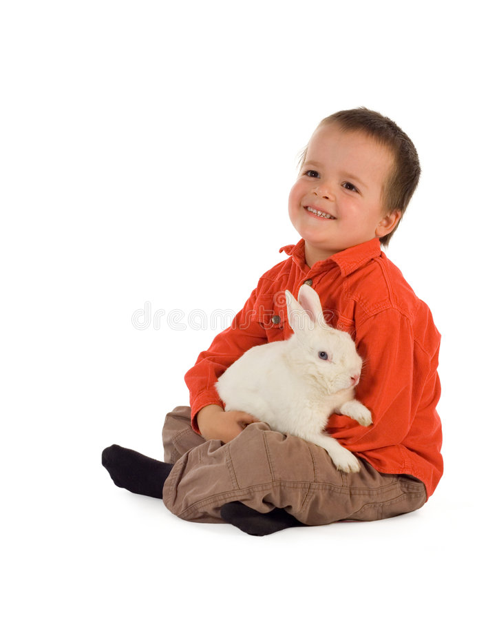 Happy boy with easter bunny stock images