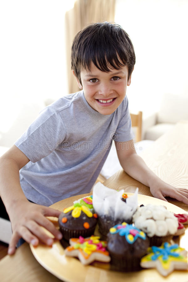 Happy boy eating colorful confectionery royalty free stock photo