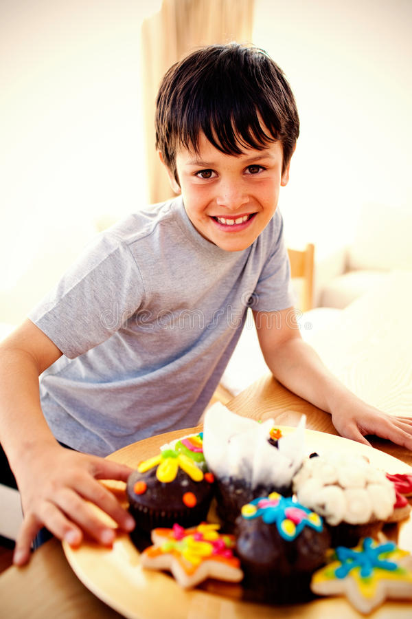 Happy boy eating colorful confectionery royalty free stock image