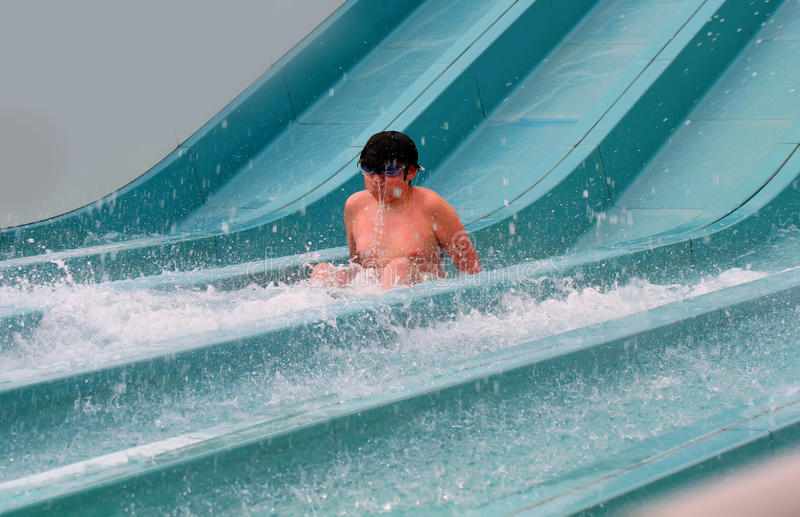 Happy boy falling into water royalty free stock photos