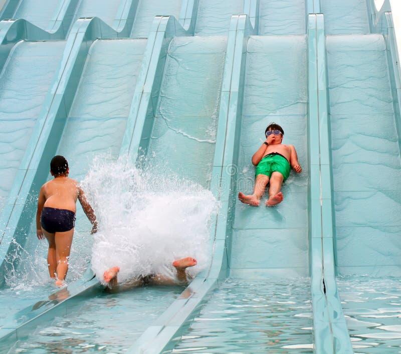 Happy boy falling into water stock photos