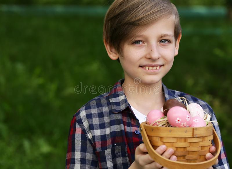 Boy with festive easter eggs. Happy boy with festive easter eggs in the park stock images