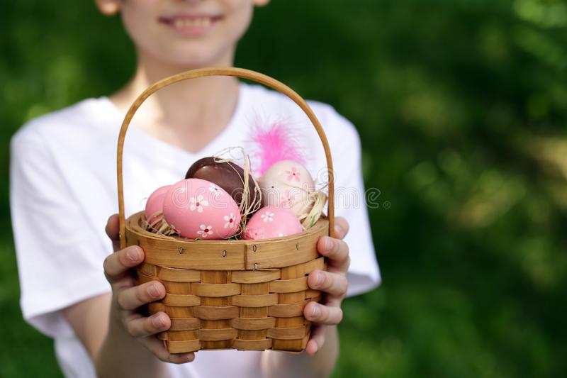 Boy with festive easter eggs. Happy boy with festive easter eggs in the park stock photo
