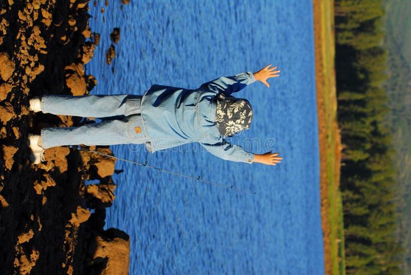 Happy boy fishing royalty free stock photo