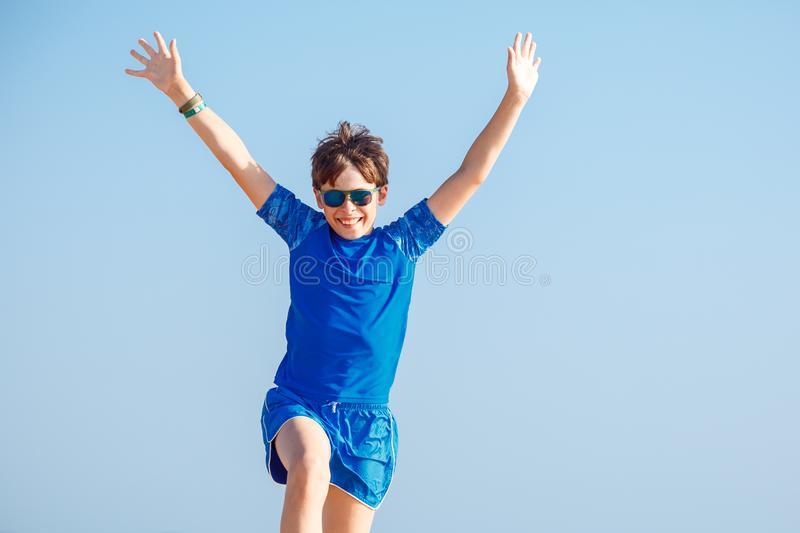 Happy boy with funny expression gesture outdoors stock photo