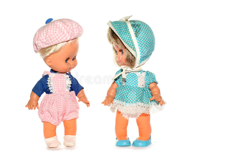 Happy boy and girl doll stock images