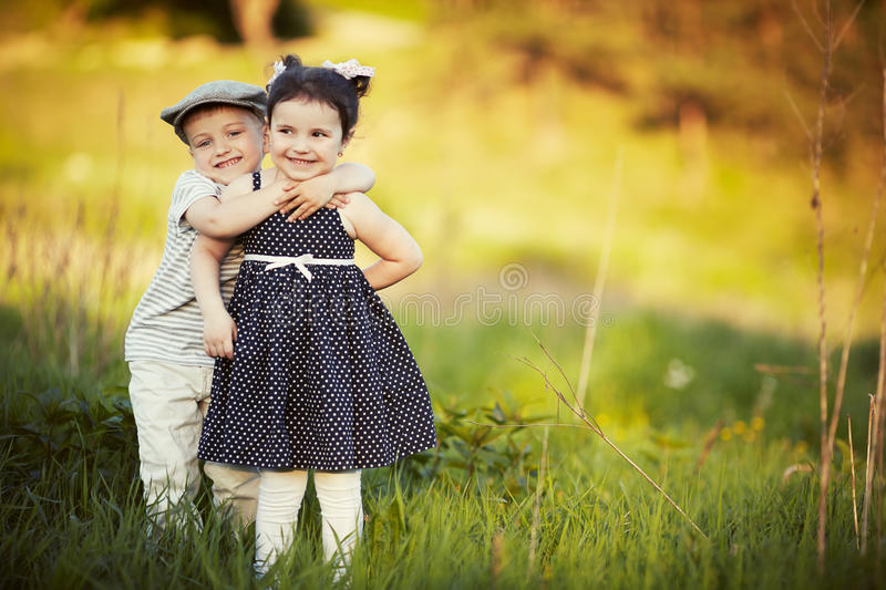 Happy boy and girl hug royalty free stock image