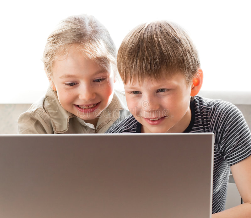 Happy boy and girl using notebook stock photography