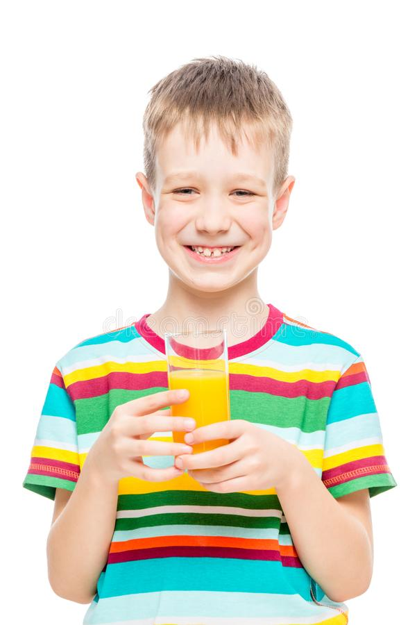 Happy boy with a glass of fresh orange juice on a white stock images